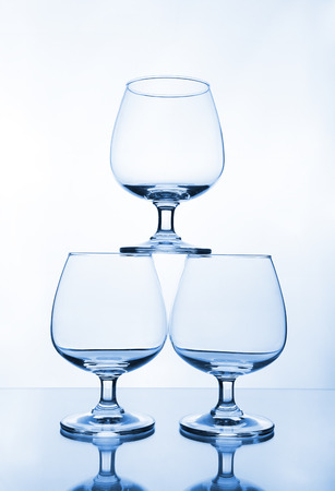stack of empty wine glass on glass table photo