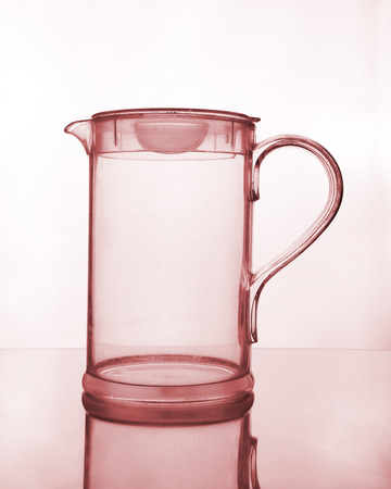 empty glass jug on glass table photo