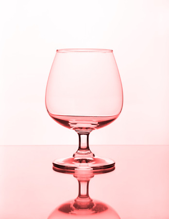 empty wine glass on glass table photo
