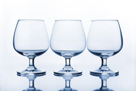 three empty wine glass with shadow photo