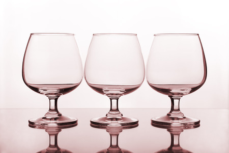 three empty wine glass on glass table photo