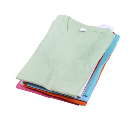 neatly: stack of colorful folded t-shirt isolated on white background (with clipping path)