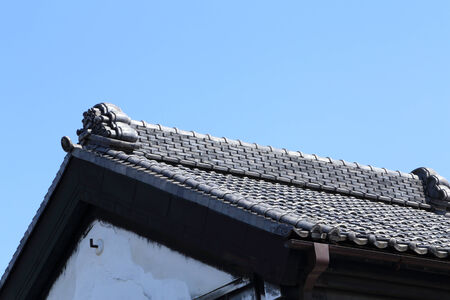 roof of traditionally japanese style with sky photo