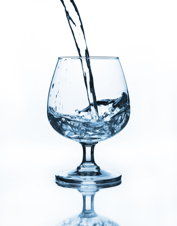 wine glass with water pouring photo