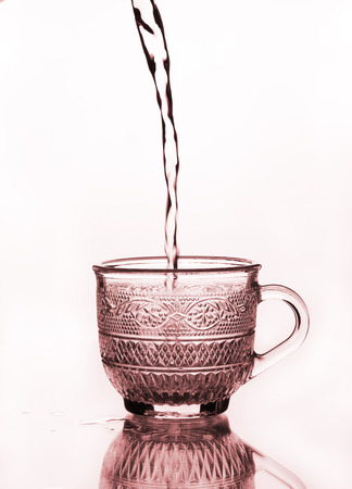 cup glass with water pouring