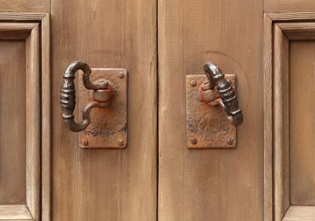 close-up of old double door knocker photo