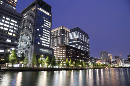 The city lights of Tokyo reflect off of the water, Japan photo