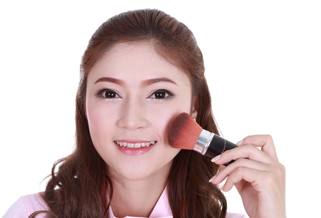 Beauty woman with Makeup Brush isolated on white background photo