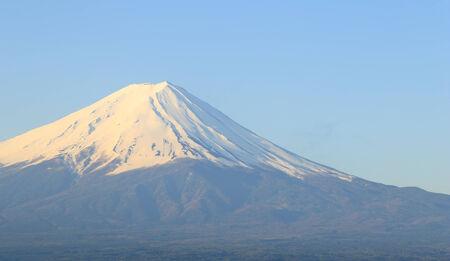peak of Mount Fuji, view from Lake Kawaguchiko, Japan photo