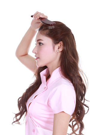 woman brushing her hair isolated on white background photo