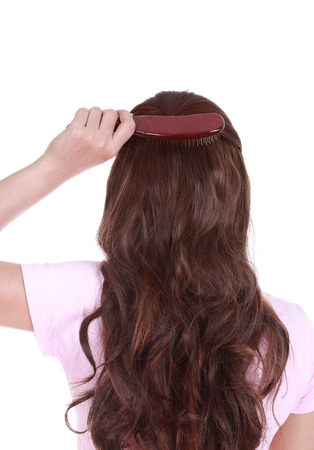 close-up woman brushing her hair isolated on white  photo