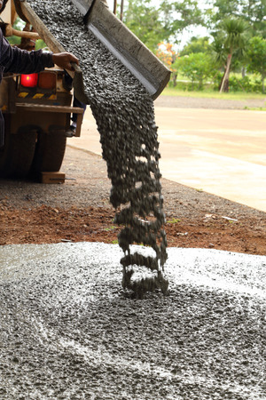 Pouring cement during sidewalk upgrade photo