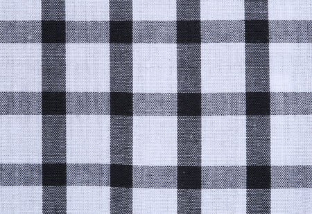 close up of gingham tablecloth fabric texture background photo