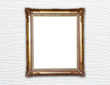 blank golden frame on wood wall background photo