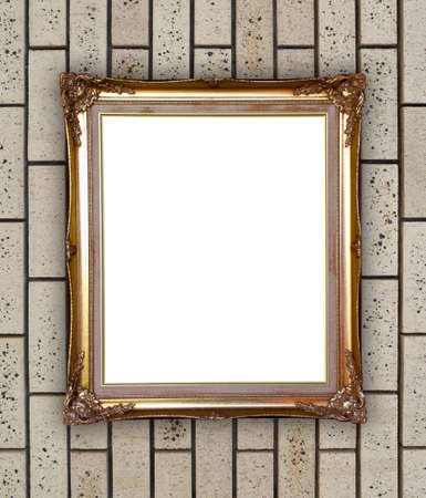 blank golden frame on brick stone wall background photo