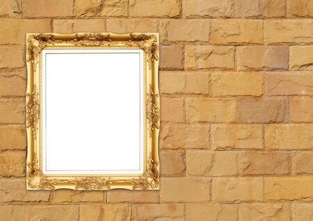 blank golden frame on brick stone wall background photo