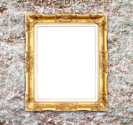 blank golden frame on ancient stone wall photo