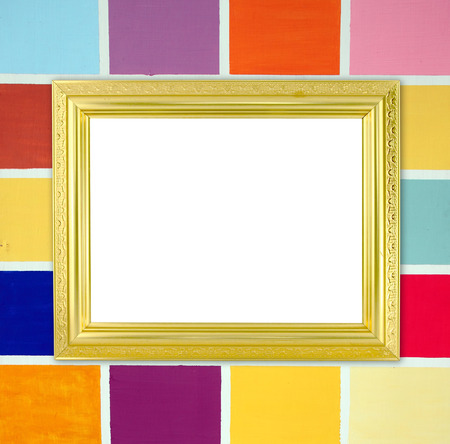 blank golden frame on colorful wood wall background photo