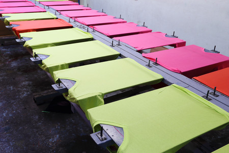 silk screen: prepare colorful t-shirt on screen table