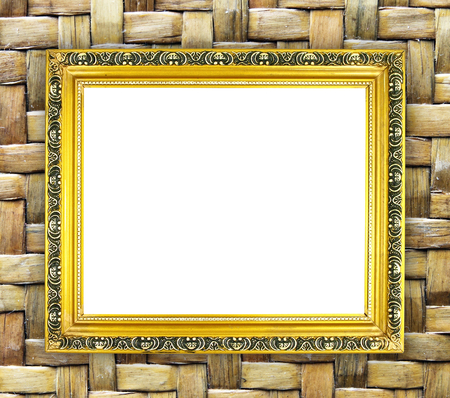blank golden frame on bamboo texture background photo