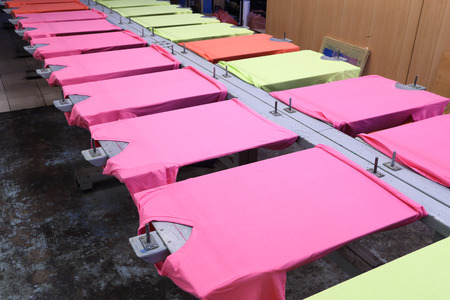 prepare colorful t-shirt on screen table photo