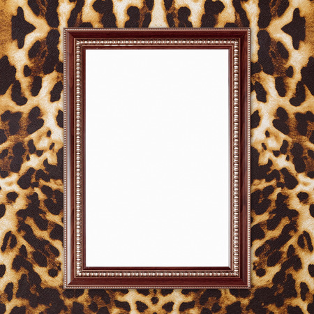 blank wood frame on leopard texture background photo