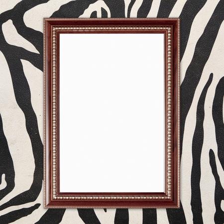 blank wood frame on zebra texture background photo
