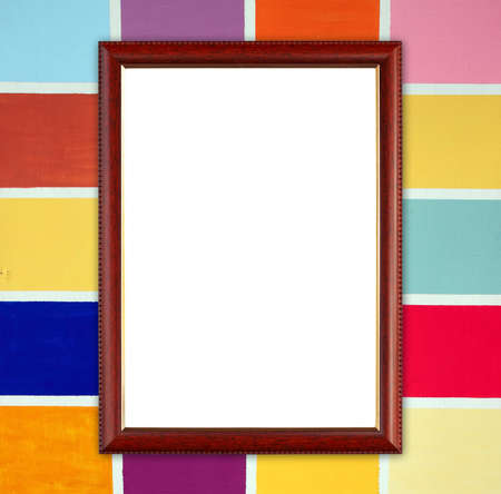 blank wood frame on colorful wood wall background photo
