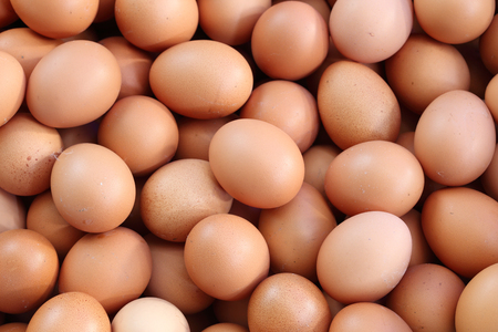 many fresh brown eggs for sale at a market photo