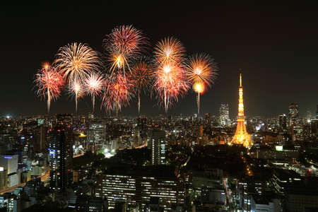 Fireworks celebrating over Tokyo cityscape at night, Japan photo