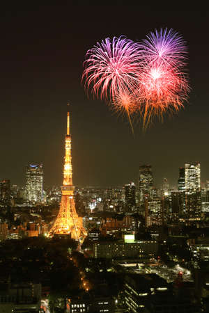 Fireworks celebrating over Tokyo cityscape at night, Japan