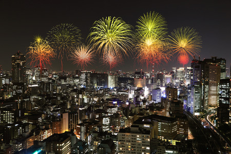 Fireworks celebrating over Tokyo cityscape at night of Japan photo