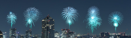 Fireworks celebrating over Tokyo cityscape at night, Japan (panorama)