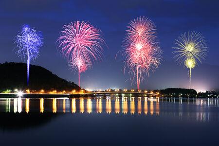 Fireworks celebrating over Lake Kawaguchiko at night with mount Fuji background, Japan photo