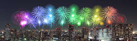 Fireworks celebrating over Tokyo cityscape at night, Japan (panorama) photo