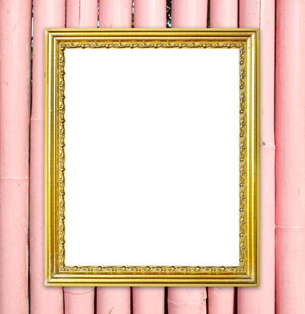 blank golden frame on colorful bamboo wall background photo