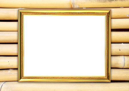 blank golden frame on bamboo wall background photo