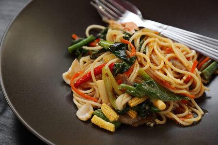 Italian pasta - spaghetti bolognese in plate, at restaurant photo