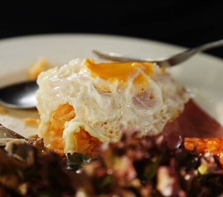 Sunny side up on fried rice on plate photo