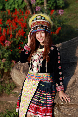 Traditionally dressed Mhong hill tribe woman in the garden at mountain photo