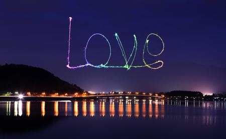 Love sparkle Fireworks celebrating over bridge of Lake Kawaguchiko at night with mount Fuji background, Japan photo