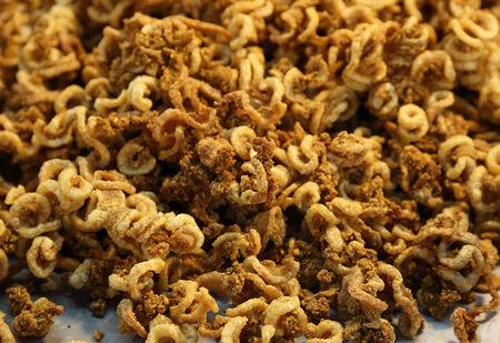 crackling: pork snack, pork rind, pork scratching or pork crackling (Thai style food) in the market Stock Photo