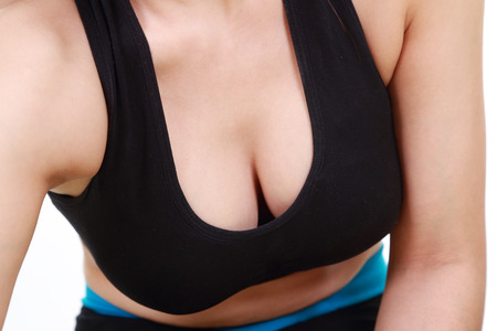 woman bra: close up of a womans chest in her sports bra