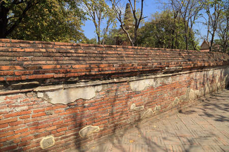 old ancient brick wall at Wat Mahaeyong, the ruin of a Buddhist temple in the Ayutthaya historical park, Thailand photo