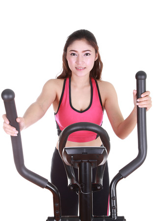 young woman doing exercises with exercise machine, on white background photo