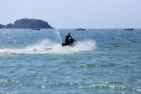 jetski: man drive on the jetski at Patong beach, Phuket, Thailand
