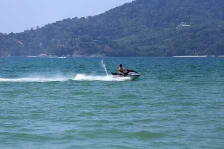 jetski: PHUKET, THAILAND - MARCH 15, 2015: Unidentified man drive on the jetski in Patong beach. on March 15, 2015 at Patong beach, Phuket, Thailand