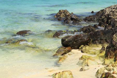 rock beach with sea at Koh Khai Nok, Thailand photo