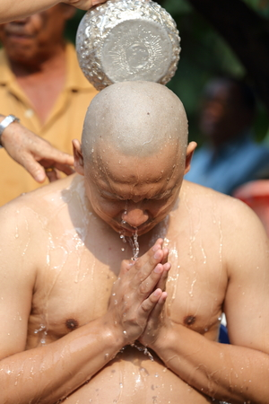 ordination: Male who will be monk shaving hair for be Ordained to new monk Stock Photo