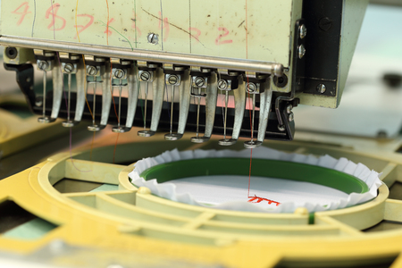 closed-up of Machine embroidery is an embroidery process whereby a sewing machine photo